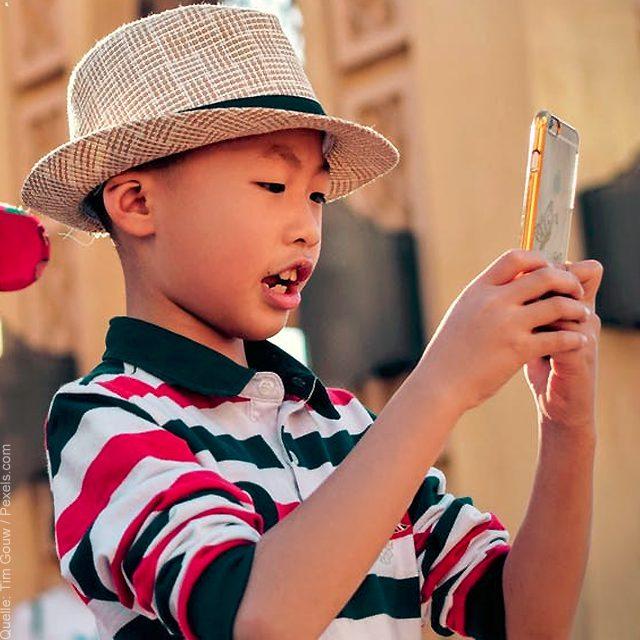 Child using smartphone, iPhone