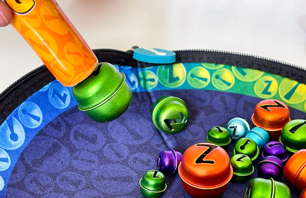 The Bellz skill game! works with small metal bells and a magnetic stick - easy, but fun!