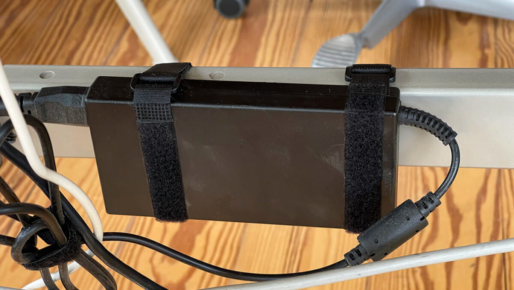 The cable ties can also be used to attach power supplies to the desk.